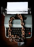 Information censorship - Typewriter locked with a chain royalty free stock images