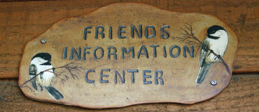 Information Center Sign. The sign over an information booth at a park Royalty Free Stock Photo