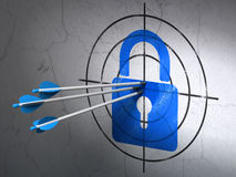 Information concept: arrows in Closed Padlock target on wall background. Success Information concept: arrows hitting the center of Blue Closed Padlock target on Stock Photos