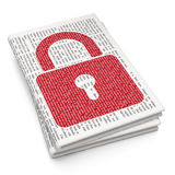 Information concept: Closed Padlock on Newspaper Royalty Free Stock Image