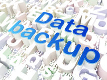 Information concept: Data Backup on alphabet background Stock Images