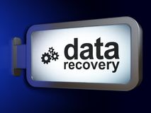Information concept: Data Recovery and Gears on billboard background. Information concept: Data Recovery and Gears on advertising billboard background, 3D Royalty Free Stock Photography