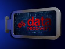 Information concept: Data Recovery and Gears on billboard background. Information concept: Data Recovery and Gears on advertising billboard background, 3D Royalty Free Stock Image