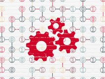 Information concept: Gears on wall background Royalty Free Stock Images