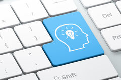 Information concept: Head With Lightbulb on computer keyboard ba. Information concept: Enter button with Head With Lightbulb on computer keyboard background, 3d Royalty Free Stock Photos