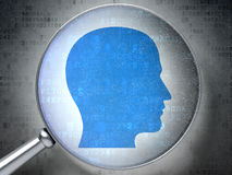 Information concept:  Head with optical glass Royalty Free Stock Photography