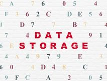 Information concept: Data Storage on wall background. Information concept: Painted red text Data Storage on White Brick wall background with Hexadecimal Code Royalty Free Stock Photos
