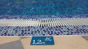 Information: Do not jump into the pool. Depth 1.2m Royalty Free Stock Images