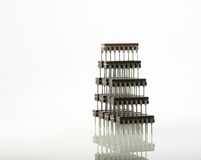 Information harmony. Pyramid formed by computer microchips with reflection Royalty Free Stock Image