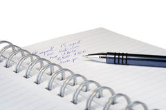 The information in a notebook. Notebook and the writing of the information on the white background (with clipping path Stock Photo