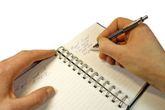The information in a notebook. Notebook and the writing of the information isolated on white ( with clipping path Stock Image