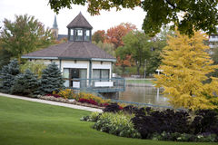 Information office by river. Pretty view of information office and fall colors by the river Royalty Free Stock Image