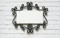 Information Plate In Forged Frame On A Brick Wall. Stock Images