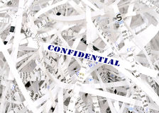 Information protection. Confidential text surrounded by shredded paper. Great concept for information protection Royalty Free Stock Photo