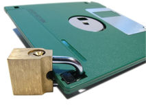 Information safety. Protection of data. Information safety. A diskette on the lock Stock Images