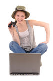 Information searching in internet. Casual woman with binocular is searching information with laptop Stock Image