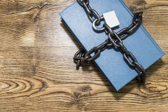 Information security concept, book with chain and padlock. royalty free stock photo
