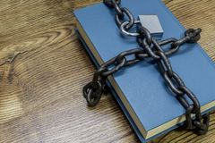 Information security concept, book with chain and padlock. stock images