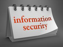 Information Security Concept on Desktop Calendar. Stock Photo