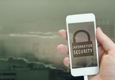 Information security concept. Information security text and lock icon on iphone screen Royalty Free Stock Image