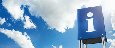 Information sign with clouds background Royalty Free Stock Image
