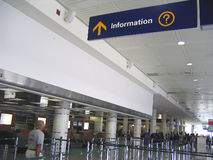 Information sign and baggage checking at airport. Information sign and baggage checking area at airport departures hall Stock Photo