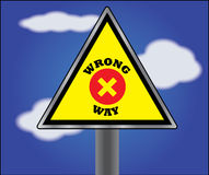 Wrong Way Information or Sign board with Blue Sky  Royalty Free Stock Photos
