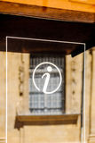Information sign icon in city environemnt. With beautiful defocused window in the background Royalty Free Stock Image
