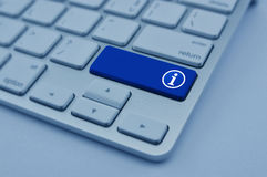 Information sign icon on modern computer keyboard button, blue t Stock Photography