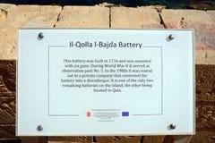 Gun battery sign at Marsalforn, Gozo. Information sign for the Il-Qolla I-Badja battery, Redoubt, Marsalforn, Gozo, Malta, Europe Stock Photo