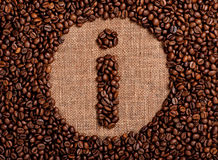 Information sign made of coffee beans. On the old burlap Stock Photo