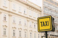 Information sign of a taxi on the background of houses in a European city. Stock Photography