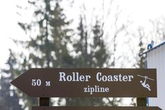 Information sign with words & x22;roller coaster zipline& x22; on it.  Royalty Free Stock Photo
