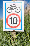 Information signboard about bicycle speed limitation. Ten kms limitation speed for a bicycle. Aiguamolls de l'Emporda . Girona. Catalonia. Spain Stock Images