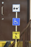 Information signs for people with disabilities near front door Stock Photos