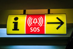 Information/SOS sign. Yellow/red sign directing to information and emergency services royalty free stock images