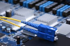Computer Network, Fiber Cable Patch Cord on Electronic Board. Information Technology Computer Network, Fiber Cable Patch Cord on Electronic Board Royalty Free Stock Photo