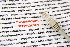 Information technology concept. A lot of topics about information technolog (words in red) and a network cable - concept background. Information technology Stock Image
