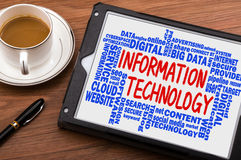 Information technology with related word cloud handwritten on ta Stock Photo