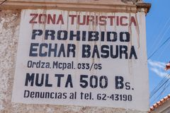 Information on a wall in Potosi, Bolivia. It says: Tourist zone. Not allowed to throw garbage. Fine 500 B. S royalty free stock images