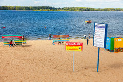 Information and warning sign at the city beach. Text in russian: Stock Photo