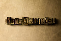 INFORMATIONAL - close-up of grungy vintage typeset word on metal backdrop Stock Photos