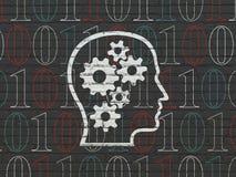 Informationsbegrepp: Huvud med kugghjul på väggen Arkivfoto