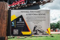 Informative plate about the Memorial Ferroviario. Campo Grande, Brazil - October 29, 2018: Informative plate with the story about the Memorial Ferroviario Maria stock images
