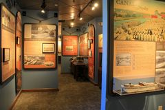 Informative posters and items explaining history of Eerie Canal Museum, Syracuse, New York, 2017. Several informative posters explaining the life of people and Stock Photos