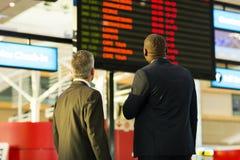 Informazioni di volo degli uomini d'affari Immagini Stock Libere da Diritti