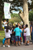 Informing About Water Usage in Miraflores, Lima, Peru. LIMA, PERU - MARCH 21, 2012: Unidentified adults and children in the Kennedy Park in the district of Royalty Free Stock Images