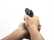 Infornamento della pistola della stretta della mano Fotografie Stock