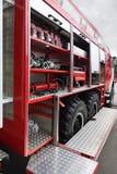 Inforni i rubinetti e l'autopompa antincendio interna dotata tubi flessibili Immagine Stock