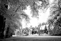 Infra-red of late mediaeval medieval Temple Church Redcliffe Bristol England UK. Looking across Temple Gardens, a one time cemetery graveyard adjoining Temple Royalty Free Stock Photo